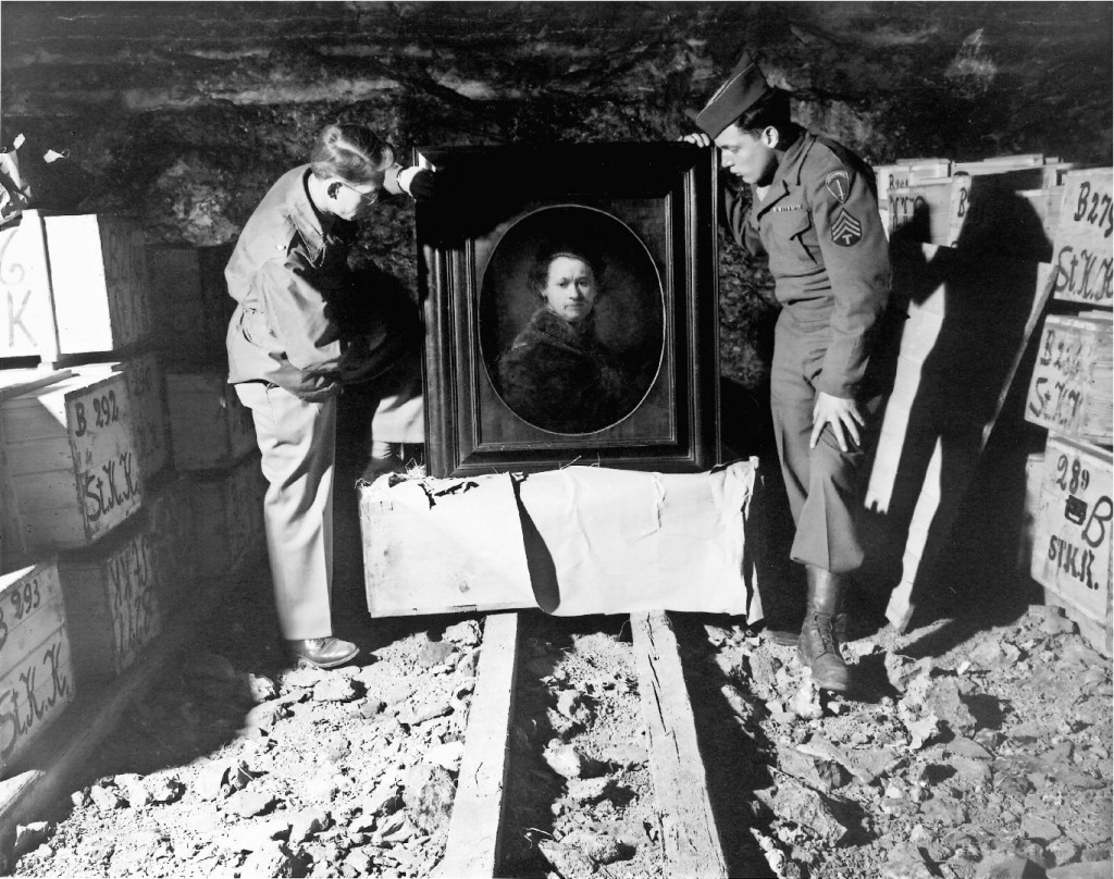 Art Second World War Heilbronn, Germany - 1946: This Self Portrait by Rembrandt, inspected by Monuments Men Dale V. Ford and Harry Ettlinger (right), was stored for safe-keeping by museum officals from Karlsruhe in the Heilbronn mine. The painting was ultimately returned to the Karlsruhe Museum. This was just one of thousands of paintings and other works of art which were found in Heilbronn as can be seen by the crates stacked behind each man. (National Archives and Records Administration, MD)